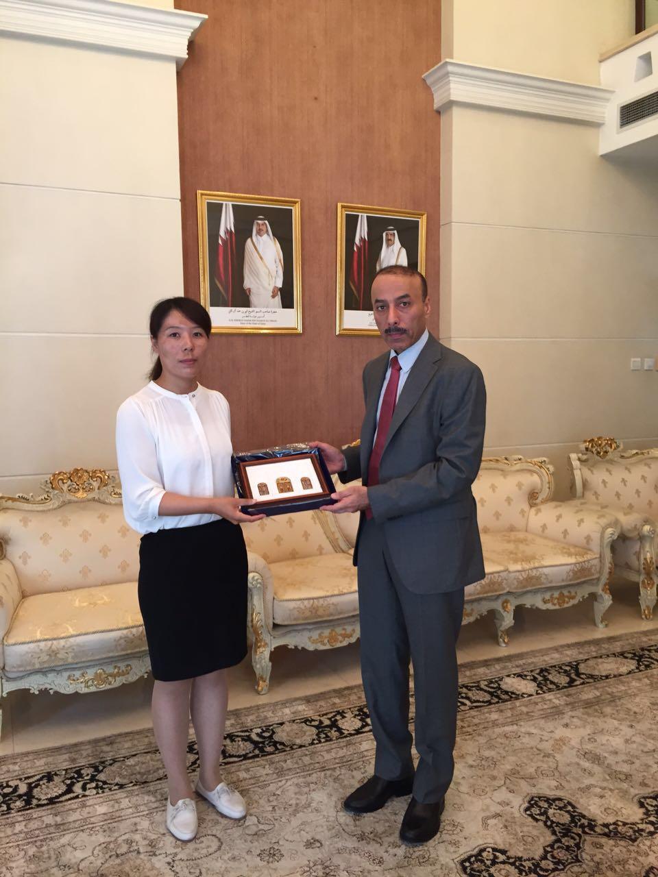 Secretary General Lucy Cui with Mr. Sultan S. Almansouri, the Ambassador of Qatar