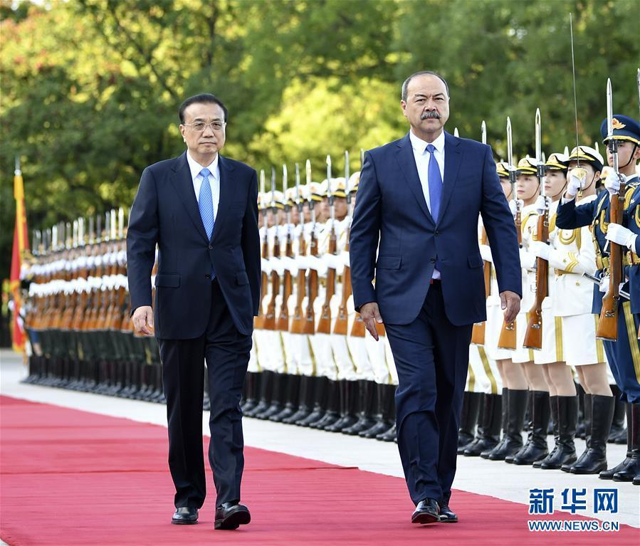 李克强同乌兹别克斯坦总理阿里波夫举行会谈